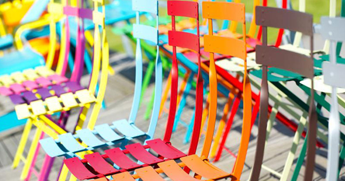 colourful metal chairs in a row