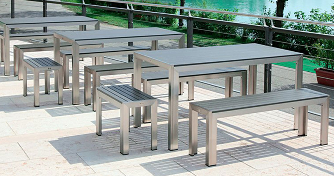 teak tables and benches outdoors